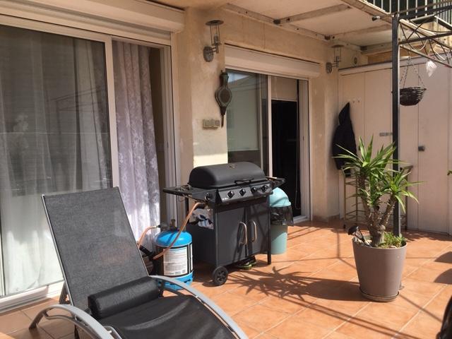 PHOTO1 - Vente appartement 4 pièces avec terrasse, garage et parking.